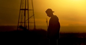 14563-boy-teen-sad-depressed-orange-man-sky-clouds-silhouette.1200w.tn